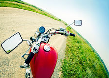 Drivers view of the cockpit in a modern motorcycle. On the country road Royalty Free Stock Photo