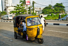 Drivers of yellow tuk tuks ply their trade around the port city Royalty Free Stock Images