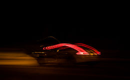 Drives the night streets. Vehicle lights up the night - long exposure light streaks Stock Photo