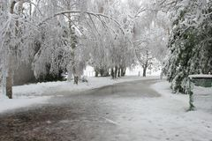 Driveway buried under snow. Driveway on a rural property buried under snow, with large puddles. Snow still falling stock photography
