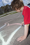 Driveway Chalk. Drawing on a driveway with chalk Royalty Free Stock Photo