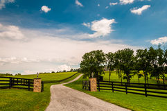 Driveway and fences in rural York County, Pennsylvania. Royalty Free Stock Photo