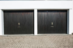 Driveway with 2 garage doors. With knobs and lockers Royalty Free Stock Photo