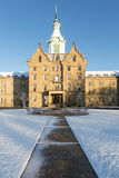 Driveway to Trans-Allegheny Lunatic Asylum. Entrance and clock tower of Trans-Allegheny Lunatic Asylum which is a Kirkbride Psychiatric hospital in Weston, West royalty free stock photos