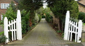 Driveway. With white old wooden gate Stock Images