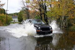Driving Through #2. Image of driver fording through flooded roadway in New England Royalty Free Stock Photos