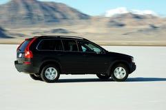 Driving. Action shot / motion blur of car driving on the Bonneville Salt Flats Stock Image