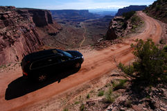 Driving. Car driving on a dirt road in Canyonlands National Park Stock Photo