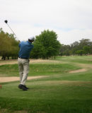 Driving. Ball leaving tee after drive Stock Photos