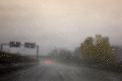 Driving. On the higway under the rain Stock Photos