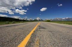 Driving. Road towards the Grand Teton, Teton National Park, Wyoming Royalty Free Stock Image