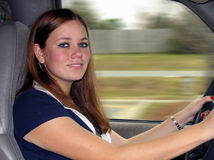 Driving. Young woman driving a car stock photography