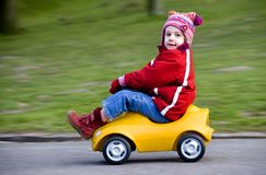 Driving. Cute child driving a bobbycar Stock Image
