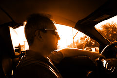 Driving. Mature man in the car Royalty Free Stock Image