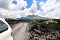 Driving across the caldera ridge road of the volcano Batur in Bali, Indonesia. Stock Photo