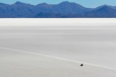 Driving across the salt flats at Uyuni Stock Image