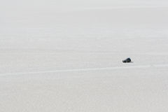Driving across the salt flats at Uyuni Royalty Free Stock Photos