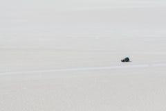 Driving across the salt flats at Uyuni Royalty Free Stock Photos