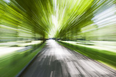 Driving along country road. Motion blur. Stock Photography