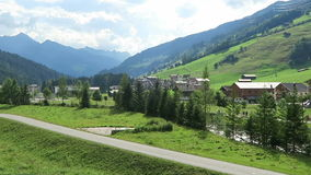 Driving along the Gerlostal valley with Gerlos village. Austria. Driving along the Gerlostal valley with Gerlos village and its typical half-timbered houses and stock video
