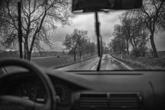 Driving along the motorway on a rainy day. Black and white Stock Photos