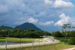 Driving along the road with beautiful landscape and blue sky. Royalty Free Stock Photography
