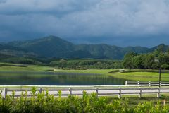 Driving along the road with beautiful landscape and blue sky. Royalty Free Stock Image