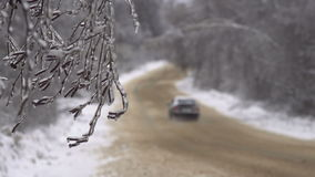 Driving along road with fallen trees, after intense ice storm. Cars go along road with fallen trees, after intense ice storm stock footage