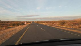 Driving along a tar highway in the Northern Cape of South Africa.  stock video
