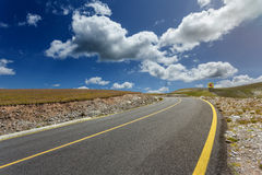 Driving on alpine asphalt road at sunshine day Royalty Free Stock Images