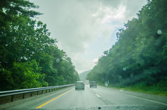 Driving on an american highway system in bad  weather Royalty Free Stock Images
