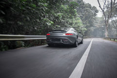 Driving the amg gt s Stock Photos