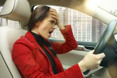 Driving around city. Young attractive woman driving a car Royalty Free Stock Photo
