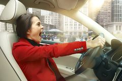 Driving around city. Young attractive woman driving a car Stock Photo