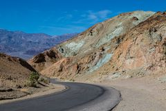 Driving Artists Drive along mineral rich rock formations. Mineral rich rock formations in Death Valley as seen from Artists drive Royalty Free Stock Image