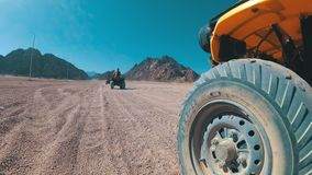 Driving of the ATV in the Desert of Egypt. Extreme view of the wheel off-road vehicle. Riding on Quad Bikes in the Desert of Egypt. Adventures of desert off stock video footage