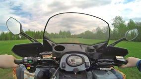 Driving ATV in forest POV stock video