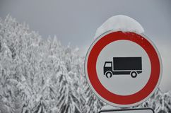 Driving ban for trucks. Stop traffic sign in the snowy forest Stock Photography