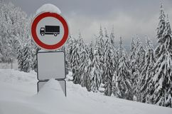 Driving ban for trucks. Stop traffic sign in the snowy forest Royalty Free Stock Photos