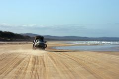 Driving on the beach. 4WD vehicule driving on the beach with a trailer (Fraser Island, Australia Royalty Free Stock Images