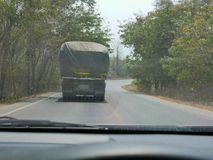 Driving behind big truck - driver`s point of view / perspective. Driving behind big truck in Thailand - driver`s point of view / perspective royalty free stock photo