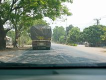 Driving behind big truck - driver`s point of view / perspective. Driving behind big truck in Thailand - driver`s point of view / perspective royalty free stock photography