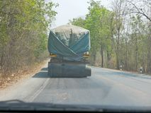 Driving behind big truck - driver`s point of view / perspective. Driving behind big truck in Thailand - driver`s point of view / perspective royalty free stock images