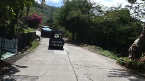 Driving on bequia's main road. A drive through a residential area in the grenadines stock video