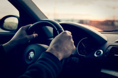 Driving a BMW 1er Royalty Free Stock Image