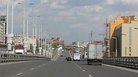Driving on the bridge named after the sixtieth anniversary of victory. Omsk. Royalty Free Stock Photo
