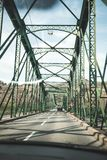 Driving through a steel bridge stock image