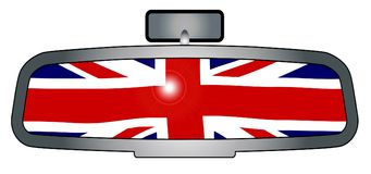 Driving Through Britain. A vehicle rear view mirror with the flag of Britain stock illustration