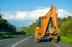 Driving bulldozer digger scraper  - construction sites vehicles Royalty Free Stock Images