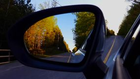 Driving Bumpy Rural Road View of Side Mirror in Daytime.  Driver Point of View POV Looking Down Side View Mirror